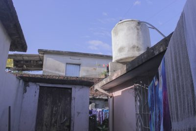 white concrete water tank on roof